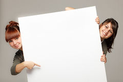Two girls holding blank banner Royalty Free Stock Photos