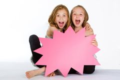 Two girls holding a blank sign Stock Photography