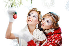 Two girls holding christmas ball Stock Photography
