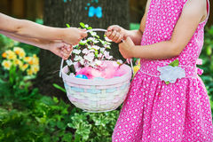 Two Girls Holding an Easter Basket with Flowers Stock Photo