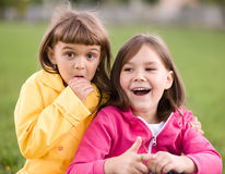 Two girls holding face in disbelief. Two cute girls holding face in disbelief Royalty Free Stock Image