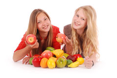 Two girls holding fresh fruits Royalty Free Stock Photo