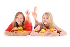 Two girls holding fresh fruits Royalty Free Stock Photography