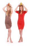 Two girls holding fresh pear on her head Royalty Free Stock Photography