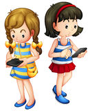 Two girls holding a gadget. Illustration of two girls holding a gadget on a white background Royalty Free Stock Photos