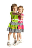 Two girls holding hands Stock Image
