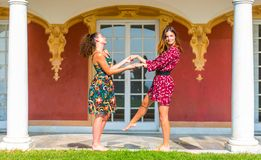 Two girls holding hands and having fun royalty free stock images
