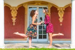 Two girls holding hands and having fun stock photography