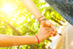 Two girls holding hands at park Stock Photos