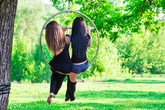 Two girls on the hoop Royalty Free Stock Photography