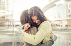 Two girls hugging each others after long time they have been dis Royalty Free Stock Photos