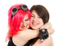 Two girls hugging and laughing. Two girls hugging and laughing, isolated over white background Royalty Free Stock Images