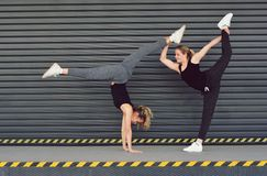 Two girls I dance aerobics on the street Royalty Free Stock Photography