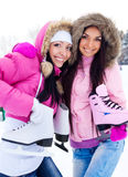 Two girls ice go skating Royalty Free Stock Photo