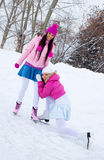 Two girls ice skating Stock Photo