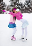 Two girls ice skating Stock Photography
