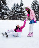 Two girls ice skating Royalty Free Stock Photos