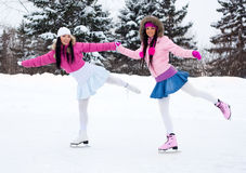 Two Girls Ice Skating Royalty Free Stock Images
