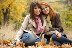 Two Girls In The Autumn Park. Stock Images