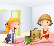 The two girls inside a room with books Stock Photography