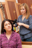 Two Girls Ironing Hair Royalty Free Stock Images