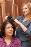 Two Girls Ironing Hair Royalty Free Stock Photography
