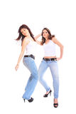 Two girls in jeans and white tshirt Royalty Free Stock Photos