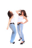 Two girls in jeans and white tshirt Stock Photo