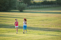 Two girls jogging. In nature stock photography