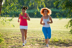 Two girls jogging. In nature Stock Images