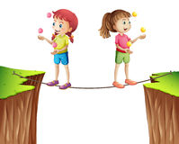 Two girls juggling balls on the rope Royalty Free Stock Photo