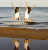 Two Girls Jumping Stock Photos