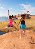 Two Girls Jumping in Celebration Royalty Free Stock Photos
