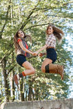 Two girls jumping Royalty Free Stock Image