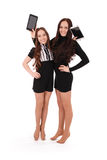 Two girls keeps tablet pc standing sideways Stock Photography