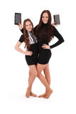 Two girls keeps tablet pc standing sideways Royalty Free Stock Photography