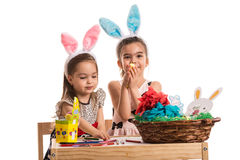 Two girls in kindergarten paint Easter eggs Royalty Free Stock Photo
