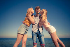Two girls kissing one boy having fun outdoor Royalty Free Stock Photography