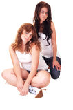 Two girls kneeling. royalty free stock photos