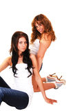 Two girls kneeling. Royalty Free Stock Images