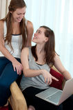 Two girls with a lap top. Royalty Free Stock Photography