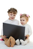 Two girls with laptop Stock Image