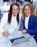 Two girls with laptop Stock Photography
