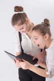 Two girls with laptop Stock Photos