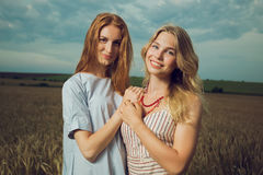Two girls laughing in field Stock Photo