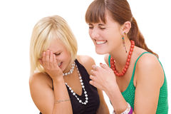 Two girls laughing on white background Royalty Free Stock Photography