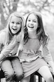 Two girls laughing. Two young pre-teen girls laughing together stock photography