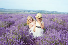Two girls  in lavender field Stock Images