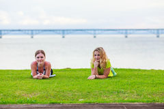 Two girls on the lawn Royalty Free Stock Photo
