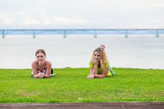 Two girls on the lawn Stock Photos